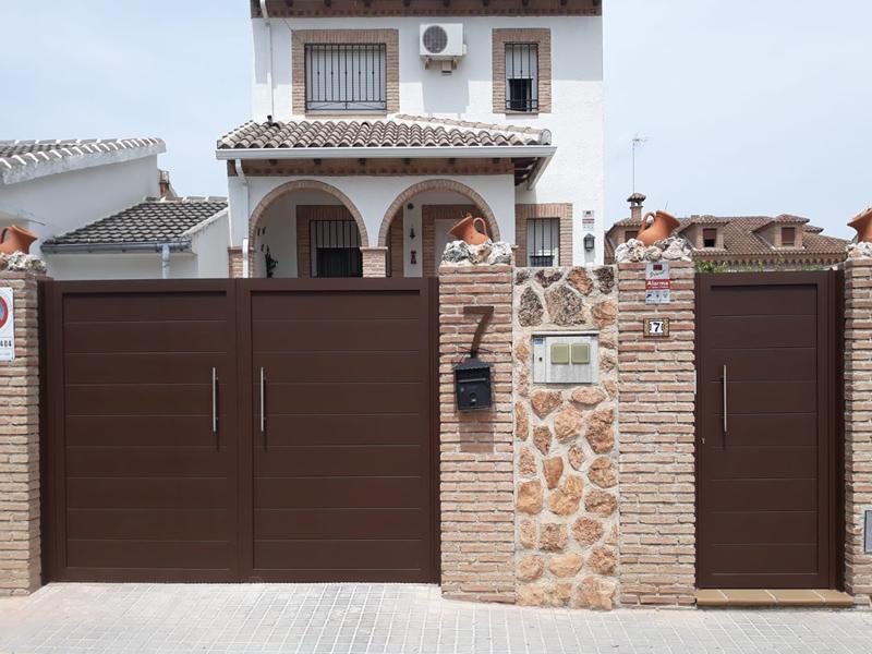 Puertas_aluminio_soldado_toledo. Tiradores_acero_inoxidable